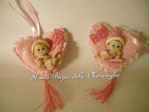 cuoricino rosa con bambolotto